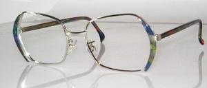 Sehr schöne Metallfassung der 70er Jahre <br /> in rhodiniertem Metall mit blaugrünen Azetat Seitenteilen