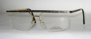 A high quality Nylor mens metal <br /> frame with gray marbled top bar and temples