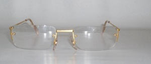 A high-quality rimless 4-hole metal eyeglass frame glazed with reading <br /> eyewear strengths in: <br /> 1