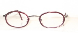A high-quality oval metal frame with wine-red inner cell rings and flexible hinges