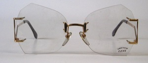A great, rimless, real '80s sunglass, with extremely fashionable bottom hangers