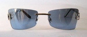 A very elegant rimless metal sunglasses by GALA with very decorative worked temples