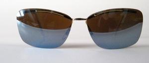 Eine fast randlose echte 50er Jahre Sonnenbrille mit goldfarbenem Oberbalken