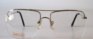 Semi-rimless 4-hole drill goggles in men's shape with clear deco glassed windows
