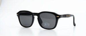 A very cool, black, stable unisex sunglasses with gold studs and flexible straps