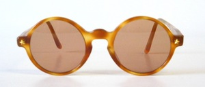 A high quality, round kids acetate sunglasses with gold studs
