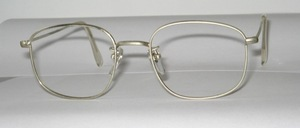 An old timeless nickel metal spectacle frame of the 60s, with nose pads