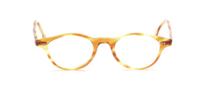 Delicate acetate frame in light honey brown with decorative studs on the front and on the temples