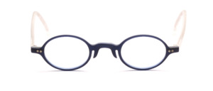 Oval acetate frame in matt dark blue with matt transparent temples and decorative rivets on the front of the middle section