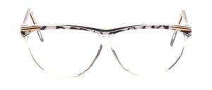 Schmetterlingsbrille in Transparent mit einem Schwarz - Weiß gemustertem Oberrahmen und Bügeln