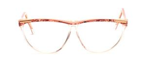 Schmetterlingsbrille in Transparent mit einem Roséfarben gemustertem Oberrahmen und Bügeln