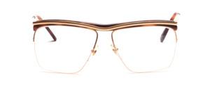 Balkenbrille aus den 80er Jahren in Gold mit braunem Acetateinsatz oben
