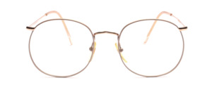 Large metal goggles from the 80s in gold with the rim of the frame with a chiselled nose bridge and temples at the top