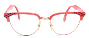 Eighties combed Frame for women in butterfly shape with a golden metal frame with a pink patterned top bar and straps
