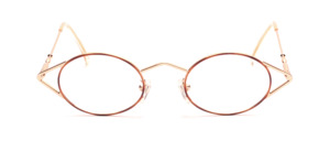 Oval golden frame with brown glass rim in a funny design