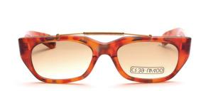 Eine modisch, sehr atraktive unisex Sonnenbrille mit goldenem Stirnbügel