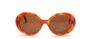 Beautiful, larger ladies wide-brimmed sunglasses and robe di kappa logo