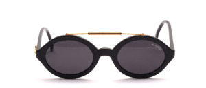 A cool, poppy oval sunglasses with a gold headband