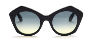 Trendy women's glasses in butterfly shape in transparent dark green with black front with glasses glazed in green course
