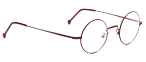 Round metal frame with flex hinge by Braun Classics patterned in brown