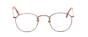 Matt golden metal frame with colorful patterned glass rim and chisels on the front and on the temples