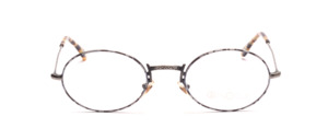 Oval metal frame in antique silver with ornate nose bridge and gray-black patterned glass rim