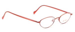 Light orange metal eyeglasses with red acetate and caramel embellishment by Binocle
