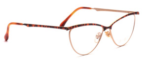 Cat eye metal frame in matt gold with a brown patterned top bar and outside of the bar