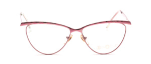 Cat-eye metal frame in pink with a pink patterned top bar and outside of the temple