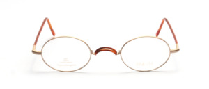 Oval glasses in matt gold with flexible hinges