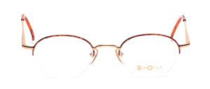 Half-rim goggles in hinted panto shape in matt gold with brown patterned glass rim