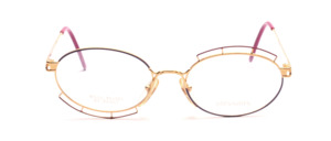Attractive metal frame in gold with decor in purple and pink