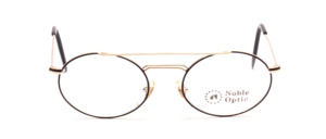 Oval metal frame in gold with double bridge and black patterned glass rim