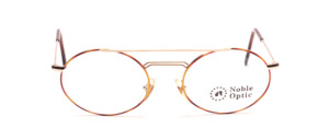 Oval metal frame in gold with double bridge and brown patterned glass rim