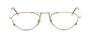 Playful men's frame in gold with green-gold patterned glass rim and ironing