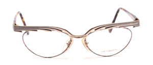 Wild Cat Eye glasses in gold metal with a colorful patterned glass rim and a bold upper edge in gold and blue