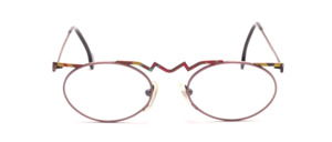 Oval metal frame in rose with a fancy colorful patterned upper edge and ironing