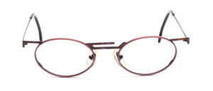 Fancy female Frame in oval in red with colorful patterned nose bridge and ironing