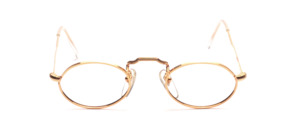 Small oval metal frame with chased rim from the 80s in gold with a raised nose bridge