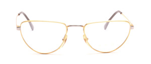 Metal frame in gold in the suggested cat eye shape with silver nose bridge and straps