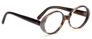 Olivfarben gemusterte ovale Brillenfassung aus den 60er Jahren mit seitlichem Strassdekor und Gravur