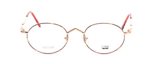 Oval, slightly slender frame in gold with a brown patterned glass rim