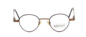 Small panto Frame in matt dark gold with a colorful patterned glass rim