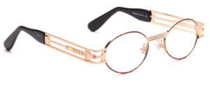 Oval ladies frame in gold with brown patterned glass rim in a fancy design