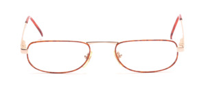 Golden reading glasses with a brown patterned glass rim and flexible hinge