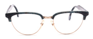Eighties comby eyeglasses for ladies in butterfly shape with a golden metal frame and a green marbled top bar and ironing