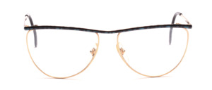 Oversized ladies' frame in gold with a green-black patterned top edge and straps