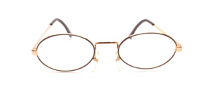 Oval metal frame in gold with a brown glass rim