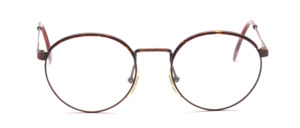 Metal frame in pantoform in metallic copper colors with a windorrand in dark brown patterned at the top of the frame