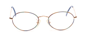 Oval metal frame in gold with a colorful patterned glass rim